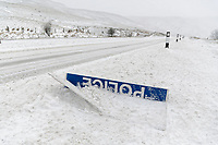 "WEATHER PICTURE WALES<br /> Pictured: A ""Police Slow"" sign covered by snow at the side of the A470 road in Storey Arms, Brecon Beacons in south Wales, UK. Friday 02 March 2018<br /> Re: Beast from the East and Storm Emma has been affecting most parts of the UK."