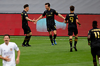 LOS ANGELES, CA - OCTOBER 25: Teammates Danny Musovski #16, Brian Rodriguez #17 and Diego Rossi #9  of the Los Angeles FC celebrate a goal during a game between Los Angeles Galaxy and Los Angeles FC at Banc of California Stadium on October 25, 2020 in Los Angeles, California.