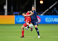 LAKE BUENA VISTA, FL - JULY 26: Nick DeLeon of Toronto FC and Maxime Chanot of New York City FC battle for position as the ball arrives during a game between New York City FC and Toronto FC at ESPN Wide World of Sports on July 26, 2020 in Lake Buena Vista, Florida.