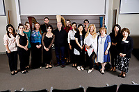 Performers and members of the jury pose for a group photo after the Composition Forum at the 11th USA International Harp Competition at Indiana University in Bloomington, Indiana on Monday, July 8, 2019. (Photo by James Brosher)