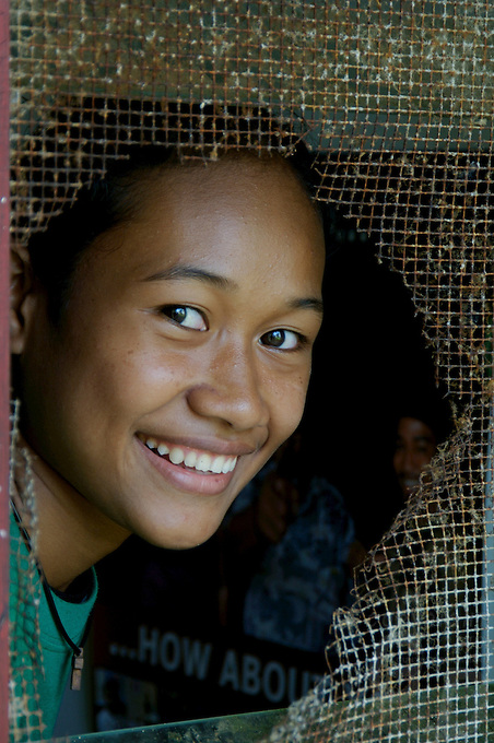 THE BIG SMILE STUDENTS IN THE PUBLIC HIGH SCHOOL CHUUK, MICRONESIA, PACIFIC,THE LOOK THROUGH A BROKEN CLASSROOM WINDOW