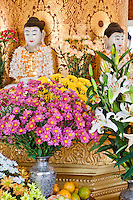 Myanmar, Burma.  Flowers and Fruit as Offerings at a Buddhist Shrine at the Zayar Thein Gyi Nunnery, near Mandalay.