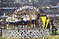 LAS VEGAS, NV - AUGUST 1: James Sands #16 of the United States lifts the Gold Cup trophy after a game between Mexico and USMNT at Allegiant Stadium on August 1, 2021 in Las Vegas, Nevada.