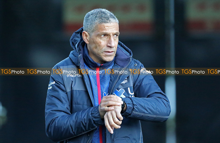 Chris Hughton manager of Nottingham Forest checks his watch during Millwall vs Nottingham Forest, Sky Bet EFL Championship Football at The Den on 19th December 2020