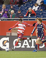 FC Dallas forward Kenny Cooper (33) crosses the ball as New England Revolution defender Chris Albright (3) closes. The New England Revolution defeated FC Dallas, 2-1, at Gillette Stadium on April 4, 2009. Photo by Andrew Katsampes /isiphotos.com
