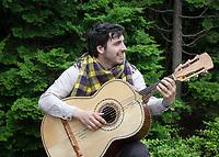 Musician playing guitar, Northwest Folklife Festival 2016, Seattle Center, Washington, USA.