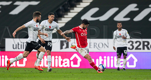 7th November 2020; Pride Park, Derby, East Midlands; English Football League Championship Football, Derby County versus Barnsley; Alex Mowatt of Barnsley takes a shot at the Derby goal