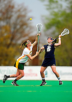1 May 2010: University of Vermont Catamount midfielder Megan MacDonald, a Junior from Wayland, MA, battles University of New Hampshire Wildcat midfielder Kate Keagins, a Sophomore from Bay Shore, NY at Moulton Winder Field in Burlington, Vermont. The Lady Catamounts fell to the visiting Wildcats 18-10 in the last game of the 2010 regular season. Mandatory Photo Credit: Ed Wolfstein Photo