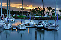 Hale'iwa Small Boat Harbor at sunset, with clouds dusting over Mount Ka'ala in the distance, North Shore, O'ahu.