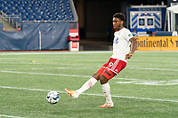 FOXBOROUGH, MA - OCTOBER 16: Nkosi Burgess #29 of North Texas SC passes the ball during a game between North Texas SC and New England Revolution II at Gillette Stadium on October 16, 2020 in Foxborough, Massachusetts.
