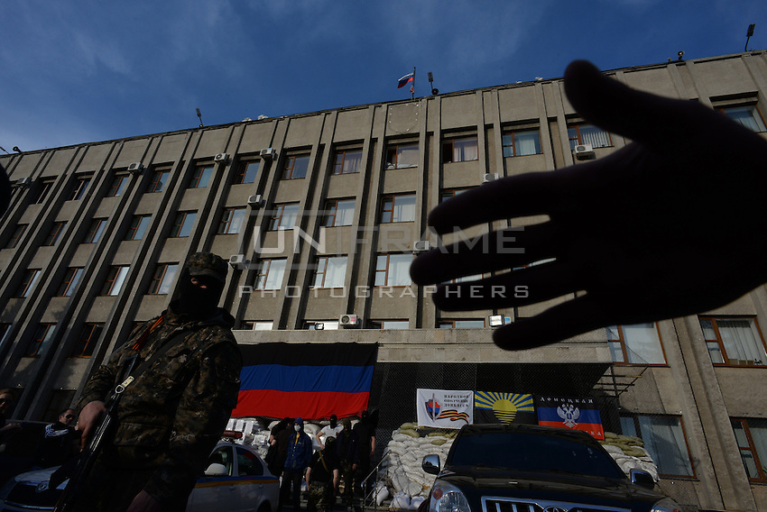"""""""No cameras"""" - pro-russian activists, members of the Civil army of Donbas protecting the city hall in Slavyansk city. Donetsk region.  Ukraine"""