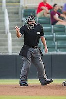 Home plate umpire Skyler Shown makes a strike call during the South Atlantic League game between the Delmarva Shorebirds and the Kannapolis Intimidators at CMC-NorthEast Stadium on July 1, 2014 in Kannapolis, North Carolina.  The Intimidators defeated the Shorebirds 5-2. (Brian Westerholt/Four Seam Images)