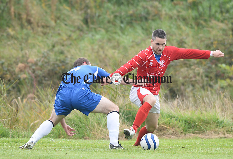 Darren Murphy of Bridge United A in action against Eoin Hayes of Newmarket A during their clash at Shannon. Photograph by John Kelly.