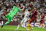 Real Madrid's Marco Asensio and AS Roma's Robin Olsen (L) and Federico Fazio (R) during Champions League match. September 19, 2018. (ALTERPHOTOS/A. Perez Meca)