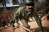 """KIA civilian militia during guerrilla training at one of the trainig camps outskirsts Laiza city, the headquarters of the Kachin Independence rebel Army. The civilian militia is called """"People's Army"""", a secret army under the command of the KIA. The KIA is enhancing its troops number since the ceasefire was broken out by the Burmese army last June 2011. During months the fighting were spread out along the Kachin State leaving more than 40,000 displaced persons and refugees (a conservative estimating) in accord with the humanitarian aid groups."""