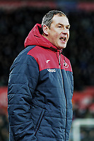 Swansea manager Paul Clement gives instructions to his players during the Premier League match between Swansea City and Manchester City at The Liberty Stadium, Swansea, Wales, UK. Wednesday 13 December 2017