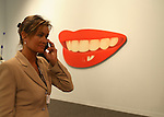 Gallerist with lips. ....Art Basel invades Miami every year in December. This is it's fifth year in South Florida. Galleries from all around the world come to Miami to show their latest works. Over $100 million worth of art was sold during the week of December 7-10.