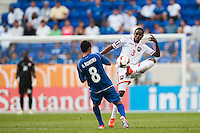 Trinidad and Tobago defender Joevin Jones (3) plays the ball under pressure from El Salvador midfielder Osael Romero (8) during a CONCACAF Gold Cup group B match at Red Bull Arena in Harrison, NJ, on July 8, 2013.