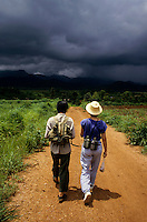 Two female hikers on a rural path.