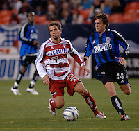 FC Dallas midfielder Simo Valakari gives chase to Colorado midfielder Terry Cooke. The Colorado Rapids drew 0-0 with FC Dallas in the first game of the Western Conference Semi-finals Invesco Field at Mile High, Denver, Colorado, September 22, 2005.