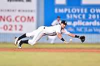 Asheville Tourists shortstop Brendan Rodgers (1) dives for the ball during a game against the Rome Braves at McCormick Field on August 22, 2016 in Asheville, North Carolina. The Braves defeated the Tourists 10-3. (Tony Farlow/Four Seam Images)