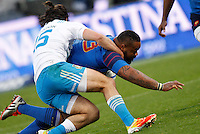 Rugby, Torneo Sei Nazioni: Italia vs Francia. Roma, stadio Olimpico, 15 marzo 2015.<br /> France's Mathieu Bastareaud, right, is challenged by Italy's Luke McLean during the Six Nations championship rugby match between Italy and France at Rome's Olympic stadium, 15 March 2015.<br /> UPDATE IMAGES PRESS/Riccardo De Luca