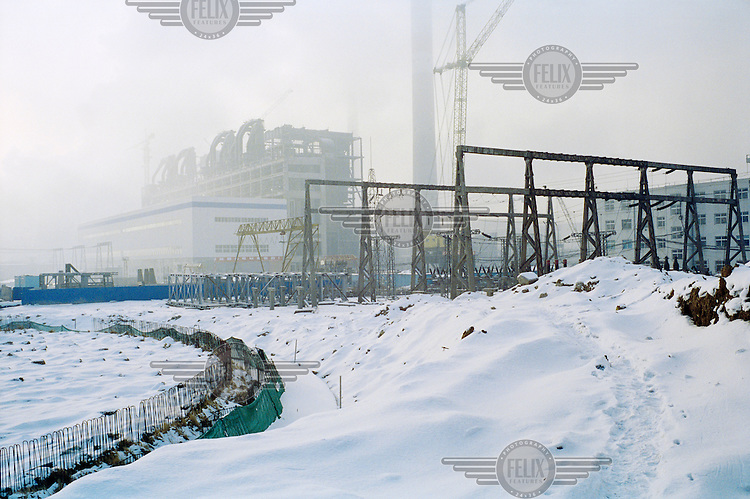 Foundations are laid for a cooling tower at a new coal-fired power station. Although still under construction, this power station is already operational. China is in the process of building over 500 new coal power plants to meet the increasing energy demand.