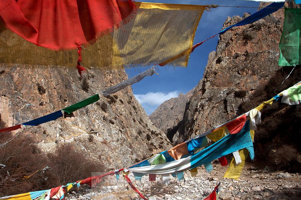 Tibetan prayer flags in a valley on the Qinghai-Tibetan Plateau. China.