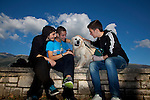 Greek students Dinos Athanasiou,18, (L) Christos Dimitriadis,18, (C) and Konstantinos Vartziotis,18, relax with their dog by the Ioannina lake.