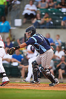 Corpus Christi Hooks catcher Roberto Pena (10) tags out the batter to complete a strike out during a game against the Arkansas Travelers on May 29, 2015 at Dickey-Stephens Park in Little Rock, Arkansas.  Corpus Christi defeated Arkansas 4-0 in a rain shortened game.  (Mike Janes/Four Seam Images)