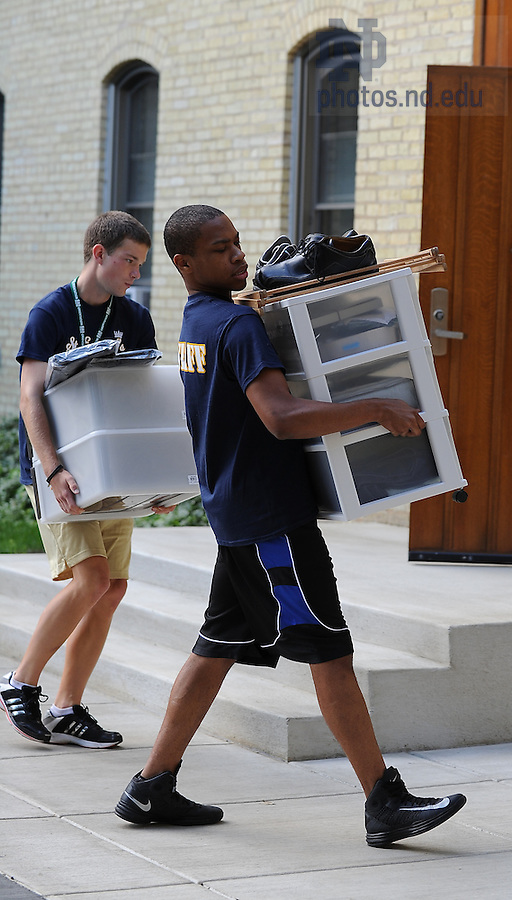 August 17, 2012; Orientation staff members help with move in day at  St. Edward's Hall.  Photo by Barbara Johnston/University of Notre Dame
