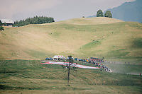 peloton approaching over the gravel roads up the Montée du plateau des Glières (HC/1390m)<br /> <br /> Stage 10: Annecy > Le Grand-Bornand (159km)<br /> <br /> 105th Tour de France 2018<br /> ©kramon