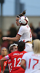 Lucy Bronze of England rises high to head