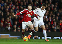 Wayne Rooney of Manchester United and Federico Fernandez of Swansea City during the Barclays Premier League match between Manchester United and Swansea City played at Old Trafford, Manchester on January 2nd 2016