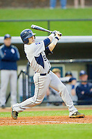 Tyler Avera (5) of the Georgia Southern Eagles follows through on his swing against the UNCG Spartans at UNCG Baseball Stadium on March 29, 2013 in Greensboro, North Carolina.  The Spartans defeated the Eagles 5-4.  (Brian Westerholt/Four Seam Images)