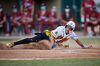 Savannah Bananas Gabe Howell (6) slides home safely during a Coastal Plain League game against the Macon Bacon on July 15, 2020 at Grayson Stadium in Savannah, Georgia.  Savannah wore kilts for their St. Patrick's Day in July promotion.  (Mike Janes/Four Seam Images)