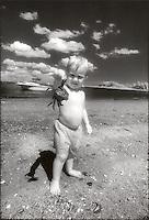Boy showing off seashore find<br />