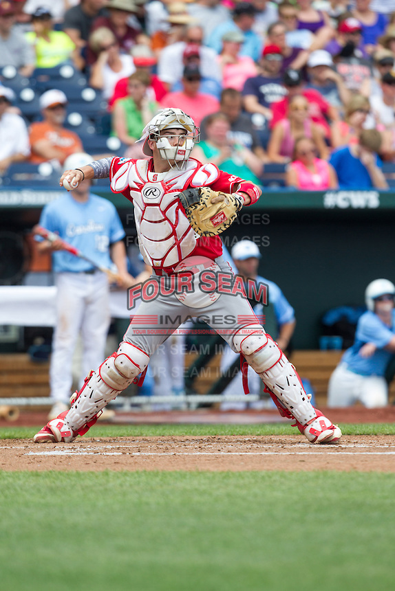 North Carolina State Wolfpack catcher Brett Austin #11 throws during Game 3 of the 2013 Men's College World Series between the North Carolina State Wolfpack and North Carolina Tar Heels at TD Ameritrade Park on June 16, 2013 in Omaha, Nebraska. The Wolfpack defeated the Tar Heels 8-1. (Brace Hemmelgarn/Four Seam Images)