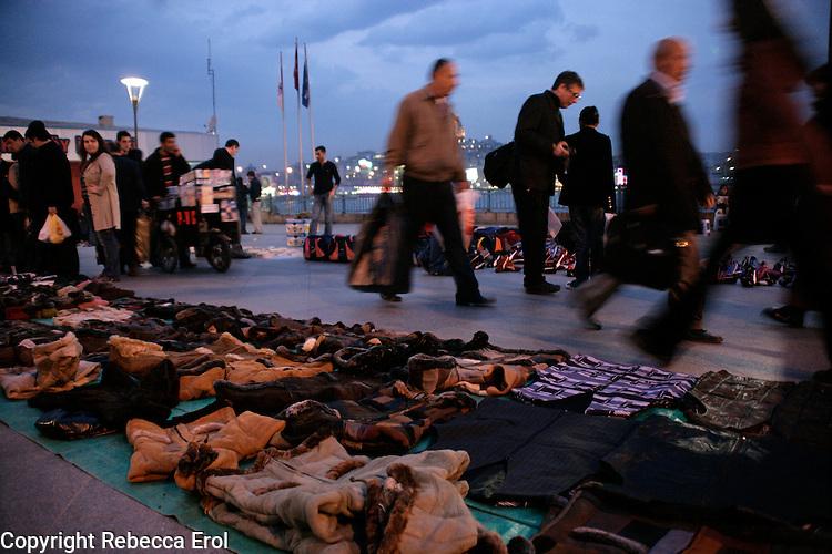 Illegal evening market at the quayside at Eminonu, Istanbul, Turkey