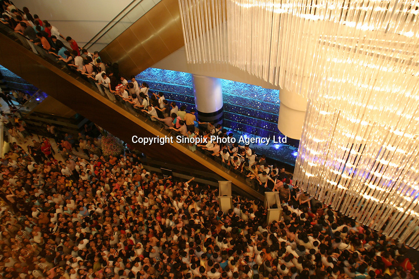 Crowds surge forward on the opening day of the Sand Casino in Macau, China, 18 May 2004. The opening marked the first time a foreign-owned gaming company was able to compete with  casino mogul Stanley Ho, who until this day held a monopoly on gaming in the former Portuguese enclave.