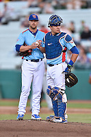 Tennessee Smokies catcher Kyle Schwarber (12) talks with pitcher Stephen Perakslis (28) during a game against the Chattanooga Lookouts on April 25, 2015 in Kodak, Tennessee. The Smokies defeated the Lookouts 16-10. (Tony Farlow/Four Seam Images)