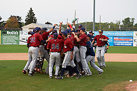 Mahoning Valley Scrappers players celebrate winning the division title during the second game of a doubleheader against the Batavia Muckdogs on September 4, 2017 at Dwyer Stadium in Batavia, New York.  Mahoning Valley defeated Batavia 6-2 to clinch the Pinckney Division Title.  (Mike Janes/Four Seam Images)