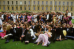 Students attend the annual May Ball up all night have their group Survivors Group Photograph taken the morning after the Commem Ball, Oxford, Magdalen College University 1980s England