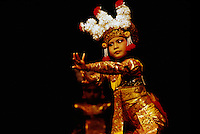 Legong Dancer - Young Balinese Girl dancing Classical Dance Performance and wearing Traditional Costume from Bali, Indonesia (No Model Release Available)