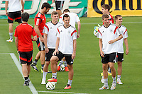 Miroslav Klose and Thomas Muller of Germany during training