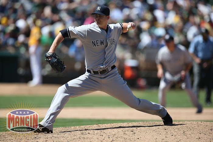 OAKLAND, CA - JUNE 13:  Boone Logan #48 of the New York Yankees pitches against the Oakland Athletics during the game at O.co Coliseum on Thursday June 13, 2013 in Oakland, California. Photo by Brad Mangin