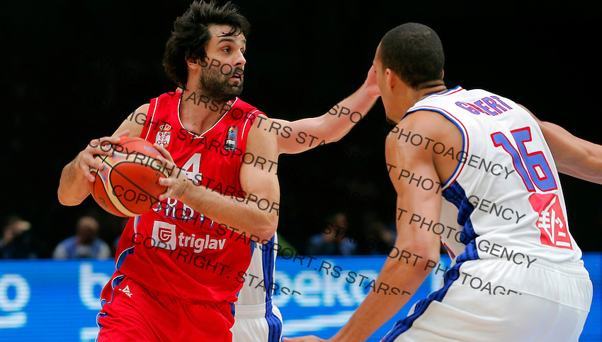 France's Rudy Gobert (R) vies with Serbia's Milos Teodosic (L) during European championship basketball match for third place between France and Serbia on September 20, 2015 in Lille, France  (credit image & photo: Pedja Milosavljevic / STARSPORT)