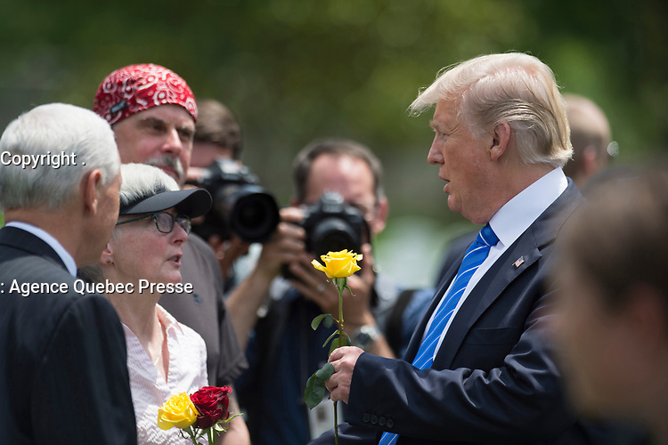 President Donald J. Trump speaks with families of fallen service members at Arlington National Cemetery Memorial Day May 29, 2017. Trump greeted and spoke with family members of fallen service members in the cemetery's Section 60. (DoD photo by EJ Hersom)