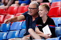 A Crystal Palace FC fan with a young relative during the pre season friendly match between Crystal Palace and Hertha BSC at Selhurst Park, London, England on 3 August 2019. Photo by Carlton Myrie / PRiME Media Images.