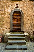 This is a classic wooden door in Civita di Bagnoregio, Italy in Umbria.